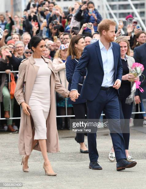 Meghan Duchess of Sussex and Prince Harry Duke of Sussex meet the public on a walkabout in Viaduct Harbour on October 30 2018 in Auckland New Zealand...