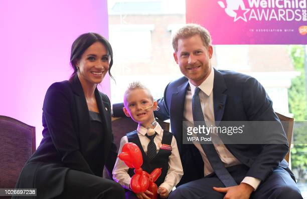 Meghan Duchess of Sussex and Prince Harry Duke of Sussex meet fouryearold Mckenzie Brackley during the annual WellChild awards at Royal Lancaster...