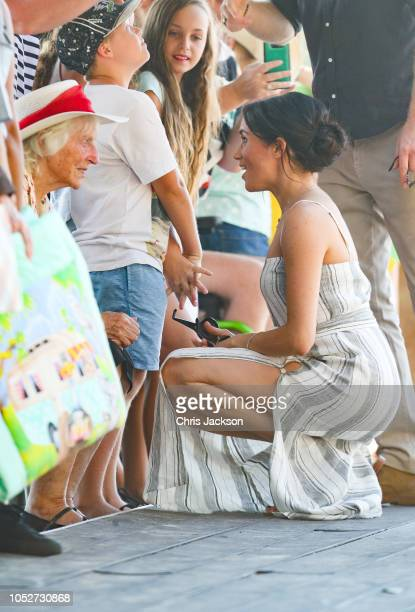 Meghan Duchess of Sussex and Prince Harry Duke of Sussex meeting young and enderly fans along a wharf in Kingfisher bay on October 22 2018 in Fraser...