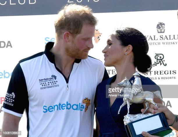 Meghan Duchess of Sussex and Prince Harry Duke of Sussex pose with the trophy after the Sentebale ISPS Handa Polo at the Royal County of Berkshire...
