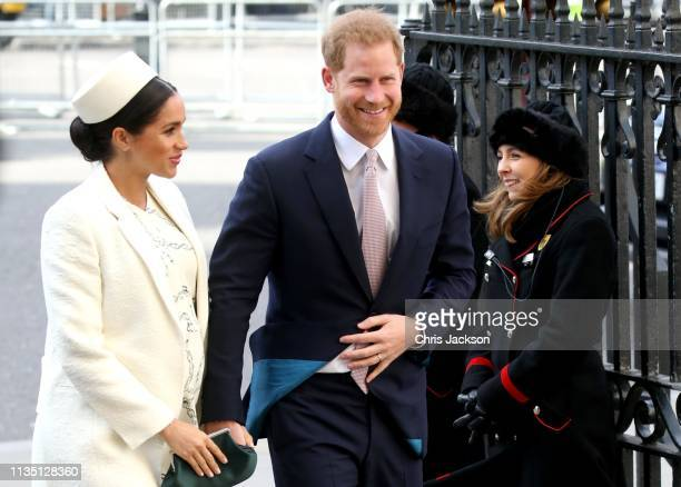 Meghan Duchess of Sussex and Prince Harry Duke of Sussex share a joke as they attend the Commonwealth Service on Commonwealth Day at Westminster...