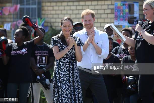 Meghan, Duchess of Sussex and Prince Harry, Duke of Sussex smile during a visit to The Justice Desk on September 30, 2019 in Cape Town, South Africa....