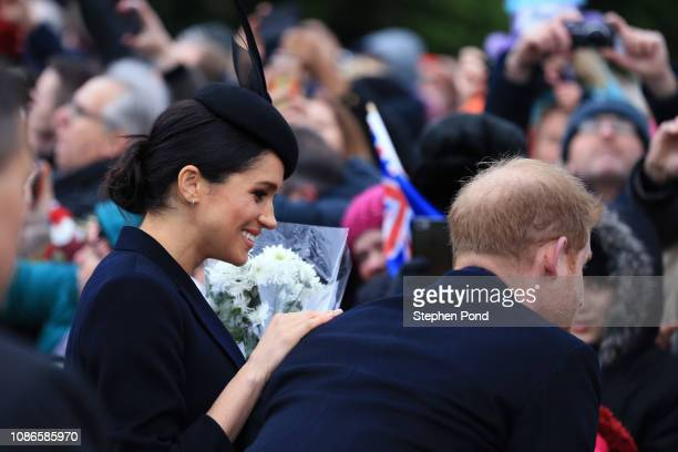 Meghan Duchess of Sussex and Prince Harry Duke of Sussex speak to well wishers after attending Christmas Day Church service at Church of St Mary...