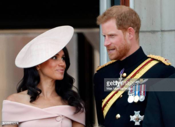 Meghan Duchess of Sussex and Prince Harry Duke of Sussex stand on the balcony of Buckingham Palace during Trooping The Colour 2018 on June 9 2018 in...