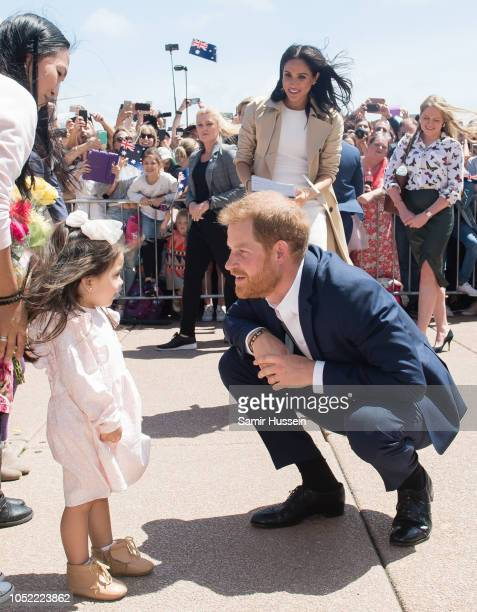 Meghan Duchess of Sussex and Prince Harry Duke of Sussex take part in a public walkabout at the Sydney Opera House on October 16 2018 in Sydney...