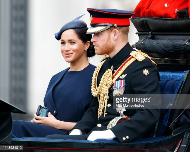 Meghan Duchess of Sussex and Prince Harry Duke of Sussex travel down The Mall in a horse drawn carriage as they attend Trooping The Colour the...