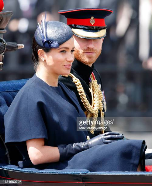 Meghan, Duchess of Sussex and Prince Harry, Duke of Sussex travel down The Mall in a horse drawn carriage during Trooping The Colour, the Queen's...