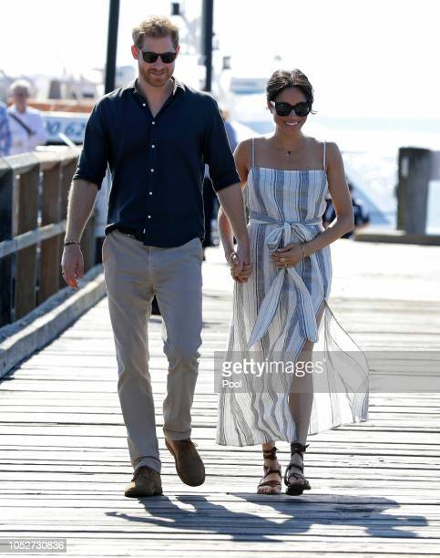 Meghan Duchess of Sussex and Prince Harry Duke of Sussex walk along Kingfisher Bay Jetty during a visit to Fraser Island on October 22 2018 on Fraser...