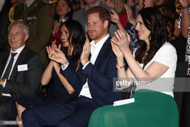 Meghan Duchess of Sussex and Prince Harry Duke of Sussex watch a cultural performance as they attend the Auckland War Memorial Museum for a reception...