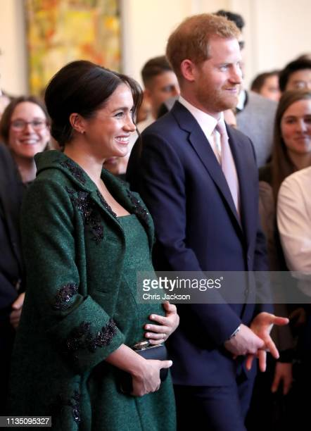 Meghan Duchess of Sussex and Prince Harry Duke of Sussex watch a musical performance as they attend a Commonwealth Day Youth Event at Canada House on...