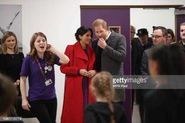 Meghan, Duchess of Sussex and Prince Harry, Duke of Sussex watch a dance troupe perform during their visit to the Hive, Wirral Youth Zone as part of...