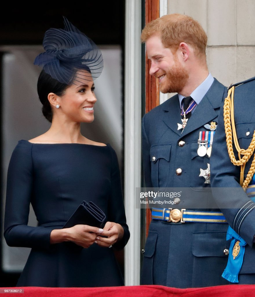 Meghan, Duchess of Sussex and Prince Harry, Duke of Sussex watch a flypast to mark the centenary of the Royal Air Force from the balcony of Buckingham Palace on July 10, 2018 in London, England. The 100th birthday of the RAF, which was founded on on 1 April 1918, was marked with a centenary parade with the presentation of a new Queen's Colour and flypast of 100 aircraft over Buckingham Palace.