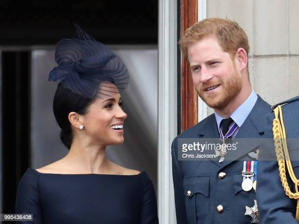 Meghan, Duchess of Sussex and Prince Harry, Duke of Sussex watch the RAF flypast on the balcony of Buckingham Palace, as members of the Royal Family...