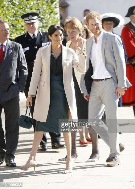 Meghan Duchess of Sussex and Prince Harry Duke of Sussex wave during an official visit to Sussex on October 3 2018 in Chichester United Kingdom The...