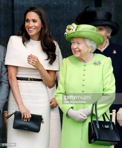 Meghan Duchess of Sussex and Queen Elizabeth II attend a ceremony to open the new Mersey Gateway Bridge on June 14 2018 in Widnes England Meghan...