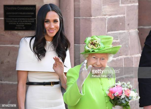 Meghan Duchess of Sussex and Queen Elizabeth II depart Chester Town Hall where they attended lunch as guests of Chester City Council on June 14 2018...