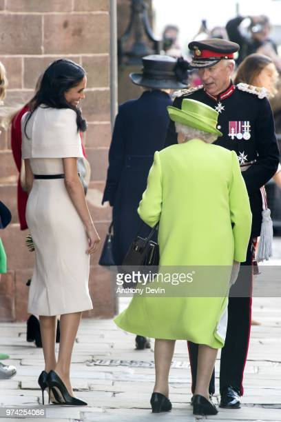 Meghan Duchess of Sussex and Queen Elizabeth II share a smile as they speak with the Lord Lieutenant as they leave Chester Town Hall on June 14 2018...