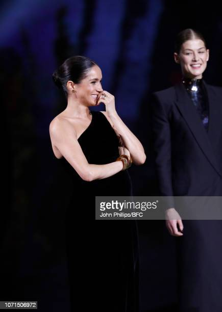 Meghan Duchess of Sussex and Rosamund Pike on stage during The Fashion Awards 2018 In Partnership With Swarovski at Royal Albert Hall on December 10...