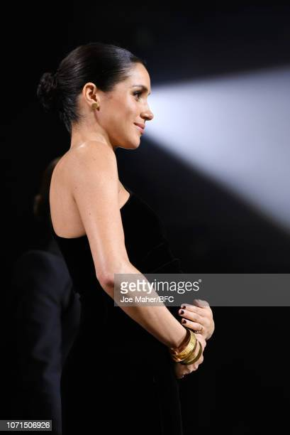 Meghan Duchess of Sussex and Rosmund Pike on stage during The Fashion Awards 2018 In Partnership With Swarovski at Royal Albert Hall on December 10...