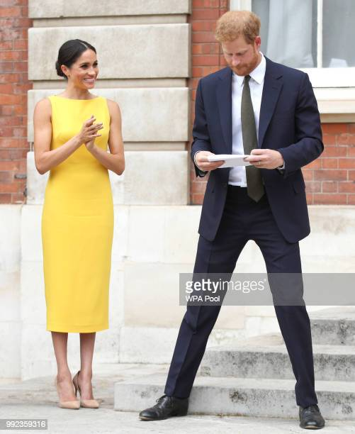 Meghan Duchess of Sussex applauds her husband Prince Harry Duke of Sussex after his speech during the Your Commonwealth Youth Challenge reception at...