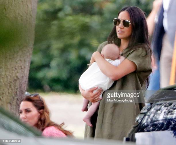 Meghan, Duchess of Sussex, Archie Harrison Mountbatten-Windsor and Catherine, Duchess of Cambridge attend the King Power Royal Charity Polo Match, in...