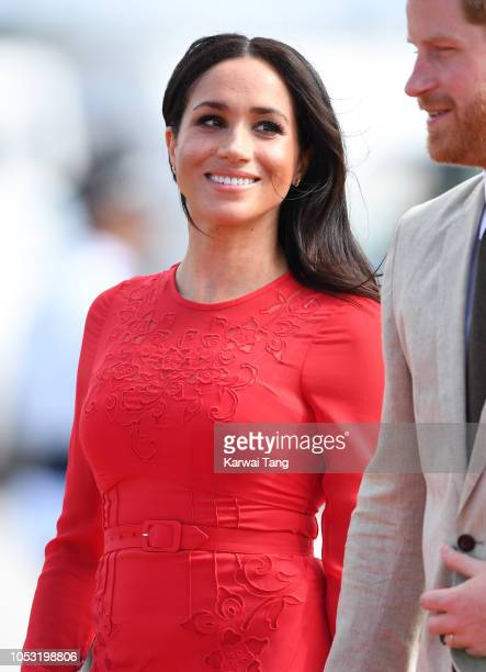 Meghan, Duchess of Sussex arrives at Fua'amotu Airport on October 25, 2018 in Nuku'alofa, Tonga. The Duke and Duchess of Sussex are on their official...