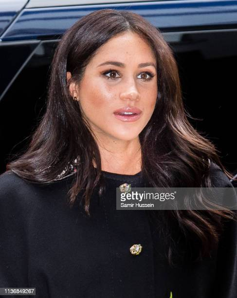 Meghan Duchess of Sussex arrives lays flowers as she arrives to sign a book of condolence at New Zealand House on March 19 2019 in London England...