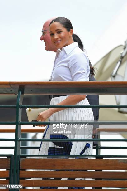 Meghan Duchess of Sussex arrives on day twelve of the Wimbledon Tennis Championships at All England Lawn Tennis and Croquet Club on July 13 2019 in...
