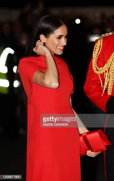 Meghan, Duchess of Sussex arrives with Britain's Prince Harry, Duke of Sussex attend The Mountbatten Festival of Music at the Royal Albert Hall in...