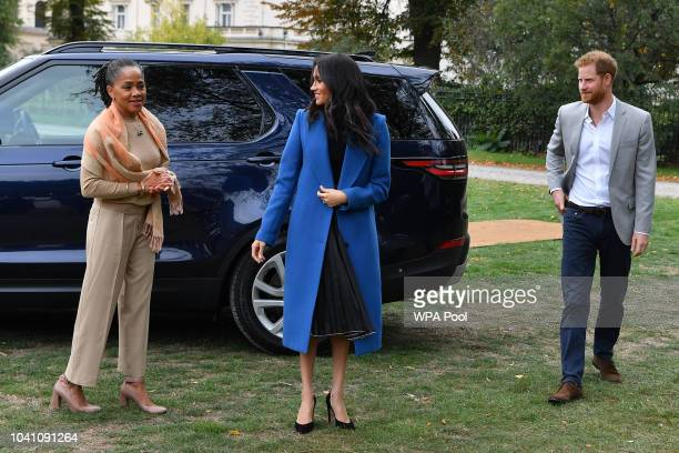 Meghan Duchess of Sussex arrives with her mother Doria Ragland and Prince Harry Duke of Sussex to host an event to mark the launch of a cookbook with...