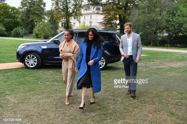 Meghan, Duchess of Sussex arrives with her mother Doria Ragland and Prince Harry, Duke of Sussex to host an event to mark the launch of a cookbook...