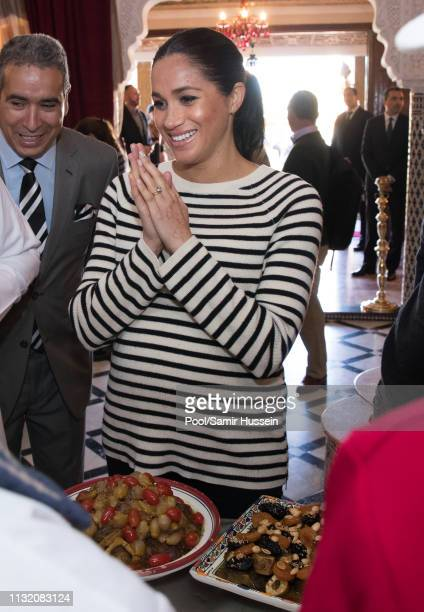 Meghan Duchess of Sussex attendS a cooking demonstration where children from underprivileged backgrounds learn traditional Moroccan recipes from one...