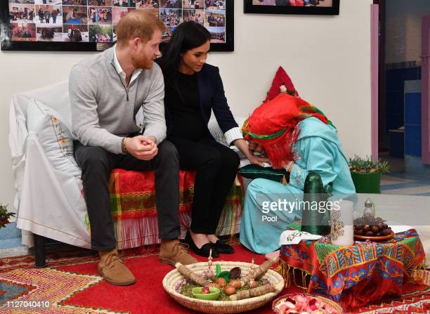 Meghan, Duchess of Sussex attends a Henna ceremony as she visits a boarding house in the town of Asni on February 24, 2019 in Asni, Morocco. The Duke...