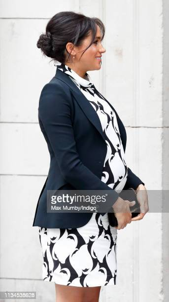 Meghan Duchess of Sussex attends a panel discussion convened by The Queen's Commonwealth Trust to mark International Women's Day at King's College...
