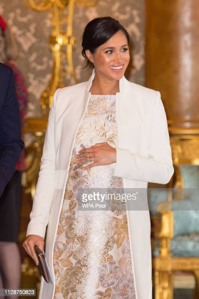 Meghan Duchess of Sussex attends a reception to mark the fiftieth anniversary of the investiture of the Prince of Wales at Buckingham Palace on March...