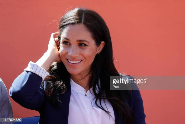 Meghan Duchess of Sussex attends an Investiture for Michael McHugo the founder of 'Education for All' with the Most Excellent Order of the British...
