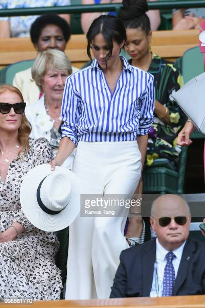 Meghan Duchess of Sussex attends day twelve of the Wimbledon Tennis Championships at the All England Lawn Tennis and Croquet Club on July 13 2018 in...