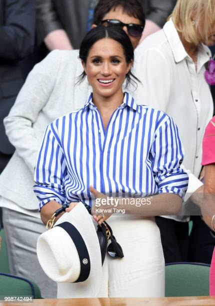 Meghan, Duchess of Sussex attends day twelve of the Wimbledon Tennis Championships at the All England Lawn Tennis and Croquet Club on July 14, 2018...