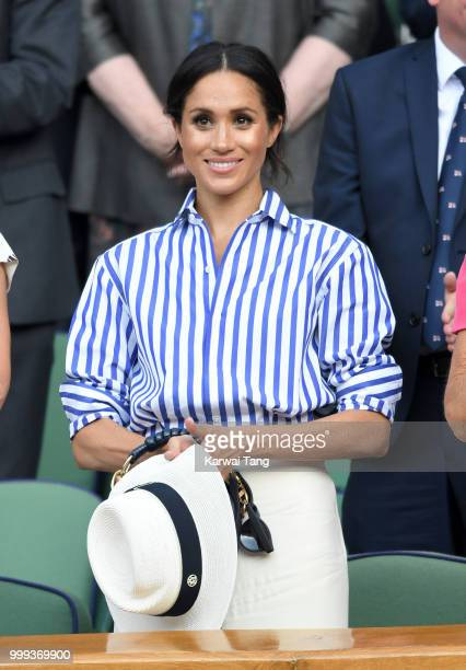 Meghan Duchess of Sussex attends day twelve of the Wimbledon Tennis Championships at the All England Lawn Tennis and Croquet Club on July 14 2018 in...