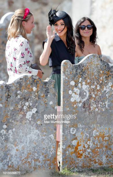 Meghan Duchess of Sussex attends the wedding of Charlie van Straubenzee and Daisy Jenks at the church of St Mary the Virgin on August 4 2018 in...