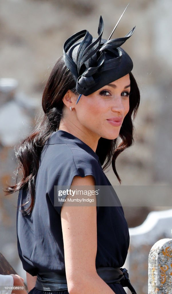 Meghan, Duchess of Sussex attends the wedding of Charlie van Straubenzee and Daisy Jenks at the church of St Mary the Virgin on August 4, 2018 in Frensham, England. Prince Harry attended the same prep school as Charlie van Straubenzee and have been good friends ever since.