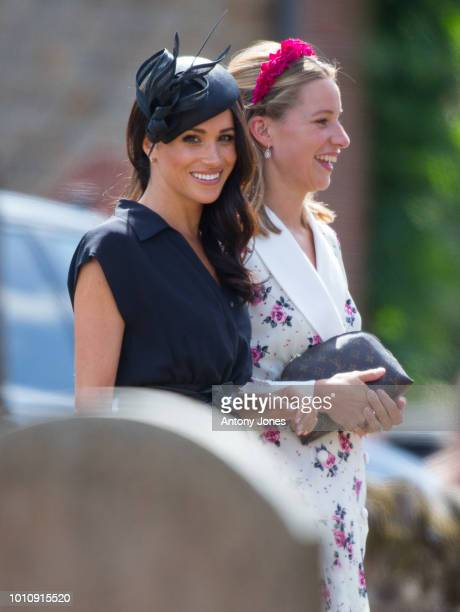 Meghan Duchess of Sussex attends the wedding of Charlie Van Straubenzee in the village of Churt in Surrey England Prince Harry attended the same prep...