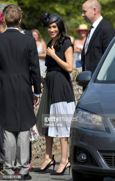 Meghan Duchess of Sussex attends the wedding of Daisy Jenks and Charlie Van Straubenzee at Saint Mary The Virgin Church on August 4 2018 in Frensham...