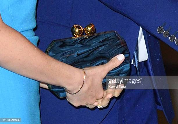 Meghan Duchess of Sussex bag detail accompanied by Prince Harry Duke of Sussex attends The Endeavour Fund Awards at Mansion House on March 05 2020 in...