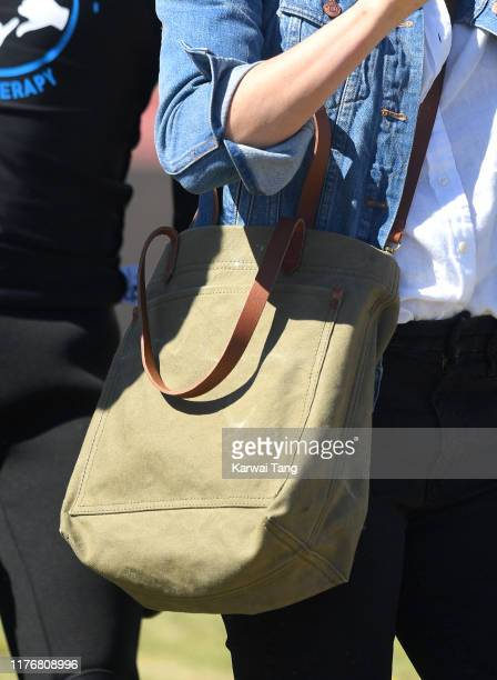 Meghan Duchess of Sussex bag detail visits Monwabisi Beach with Prince Harry Duke of Sussex where they learn about the work of 'Waves for Change'...