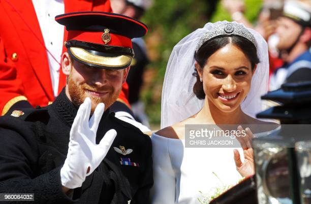 Meghan Duchess of Sussex begins her carriage procession with Britain's Prince Harry Duke of Sussex in the Ascot Landau Carriage after their wedding...