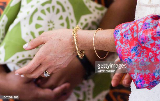 Meghan Duchess of Sussex bracelet detail attends a morning tea reception at the British High Commissioners Residence on October 24 2018 in Suva Fiji...
