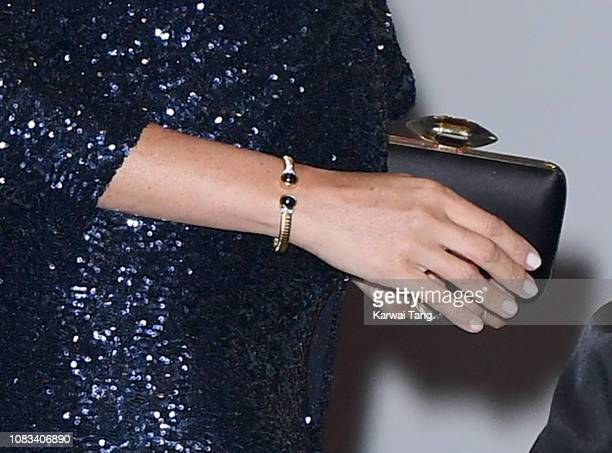 Meghan Duchess of Sussex bracelet detail attends the Cirque du Soleil Premiere Of TOTEM at Royal Albert Hall on January 16 2019 in London England