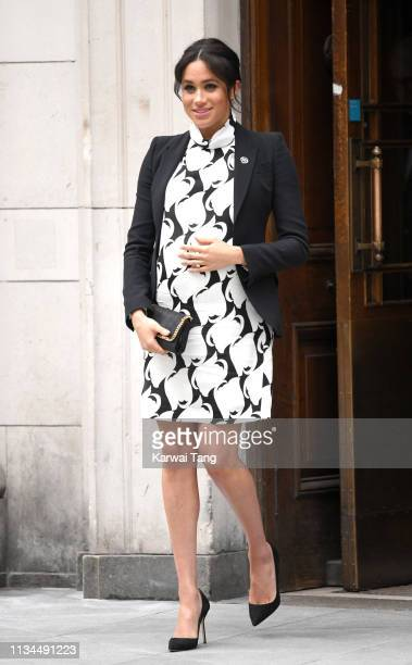 Meghan Duchess of Sussex departs after joining a panel discussion convened by The Queen's Commonwealth Trust to mark International Women's Day at...