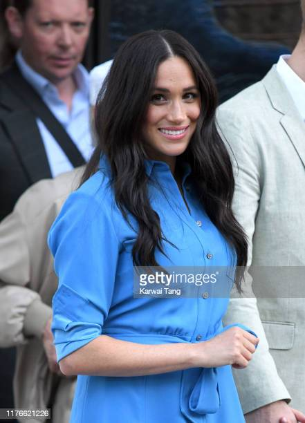 Meghan Duchess of Sussex departs with Prince Harry Duke of Sussex after visiting the District Six Homecoming Centre during their royal tour of South...
